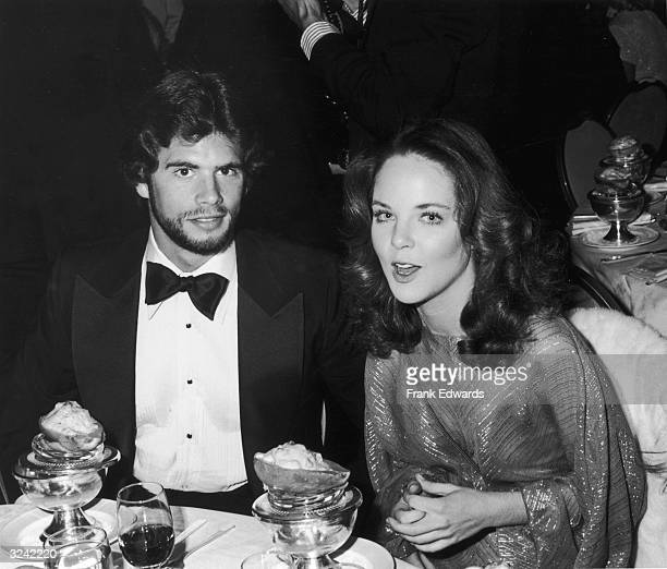 American actor Lorenzo Lamas and his date American actor Melissa Sue Anderson of the television show 'Little House on the Prairie' sit at a table at...