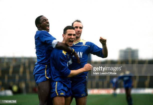 01 January 1988 English Football League Division One Wimbledon v Derby County Vinnie Jones celebrates his goal with Wimbledon colleagues John Fashanu...
