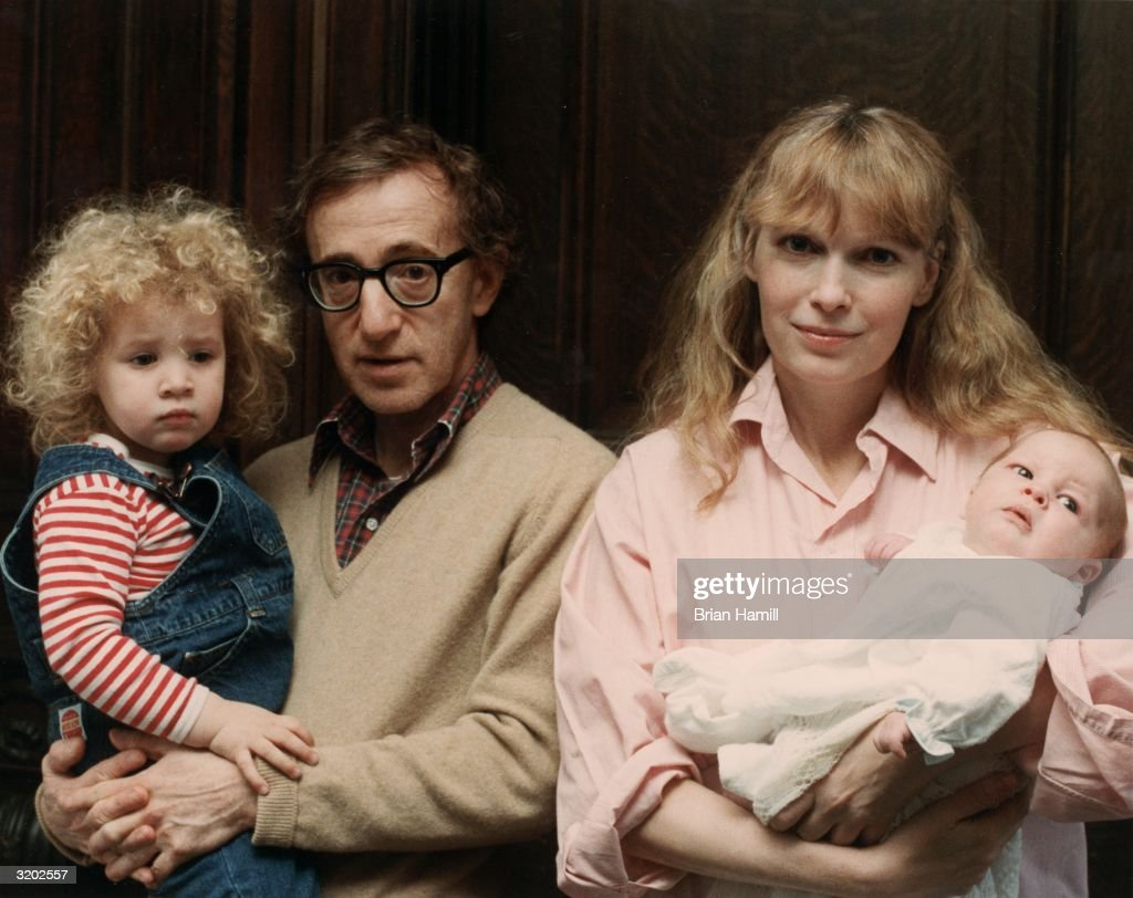 Portrait of American film director and actor Woody Allen and his girlfriend, American actor Mia Farrow, posing with their daughter, Dylan (L), and their son, Satchel, shortly after his birth. RESTRICTED. PLEASE