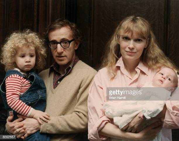Portrait of American film director and actor Woody Allen and his girlfriend American actor Mia Farrow posing with their daughter Dylan and their son...
