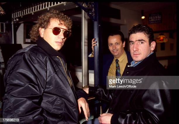 January 1991 - Eric Cantona arrives for a trial at Sheffield Wednesday Football Club - Cantona waits at the bar with friends.
