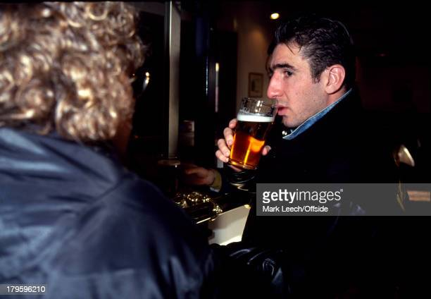 27 January 1992 Eric Cantona arrives for a trial at Sheffield Wednesday Football Club Cantona drinks a pint of beer while he waits