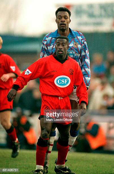 8 January 1994 FA Cup 3rd Round Stockport County v Queens Park Rangers Stockport striker Kevin Francis towers head and shoulders above Clive Wilson...
