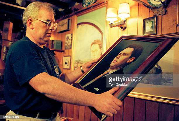 In the bar of the Black Lion Hotel in New Quay Wales a man admires a portrait of Welsh poet and writer Dylan Thomas who lived in the village with his...