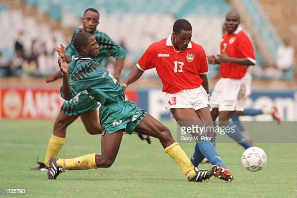 Liberia's Jonathan Sogbie in a challenge with Yves Essende of Zaire during Zaire's 20 victory over Liberia at the FNB Stadium Johannesburg in the...