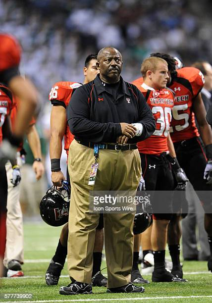 Texas Tech University Interim Head Coach Ruffin McNeill watches the offince warm up before the start of the 2010 Valero Alamo Bowl at the Alamodome...