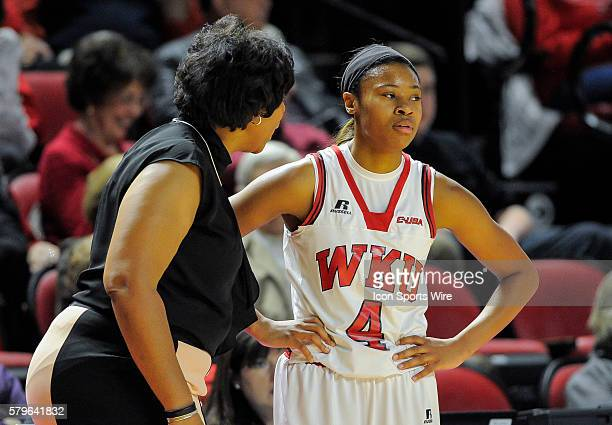 Western Kentucky Lady Toppers head coach Michelle Clark Herd scolds Western Kentucky Lady Toppers forward Dee Givens during a break in the action...