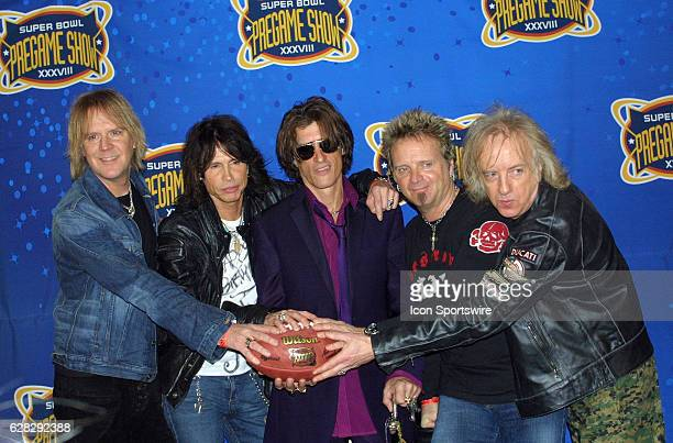 AEROSMITH posing after their press conference for the SUPER BOWL PreGame show of SUPER BOWL XXXVIII that was played at Reliant Stadium in Houston...