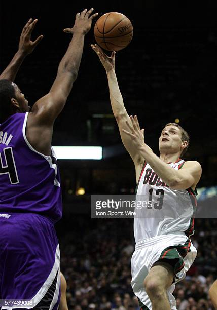 Milwaukee Bucks guard Luke Ridnour puts a lay up over Sacramento Kings forward Jason Thompson in the first quarter of an NBA game at the Bradley...