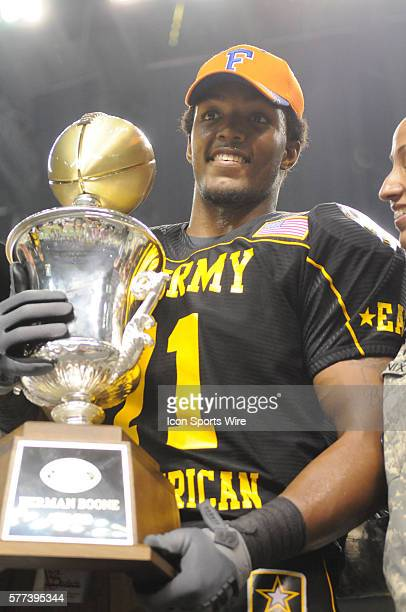 US Army AllAmerican Bowl East OT Xavier Nixon holds the championship trophy after the East defeated the West 3017 in the 2009 the US Army AllAmerican...