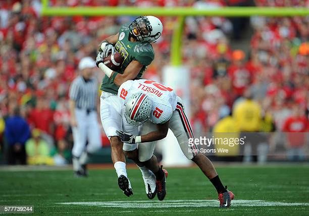 Oregon Lavasier Tuinei makes a catch and is tackled hard by Ohio State Anderson Russell during the Rose Bowl game between the Ohio State Buckeyes and...