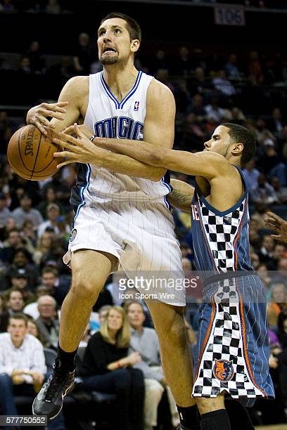 Orlando Magic forward Ryan Anderson has the ball stripped by Charlotte Bobcats guard DJ Augustin during an NBA basketball game at Time Warner Cable...