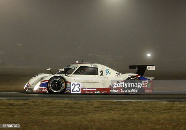 The United Autosports with Michael Shank Racing car driven by Mark BlundellZak Brown Martin Brundle and Mark Patterson enters a foggy horseshoe turn...