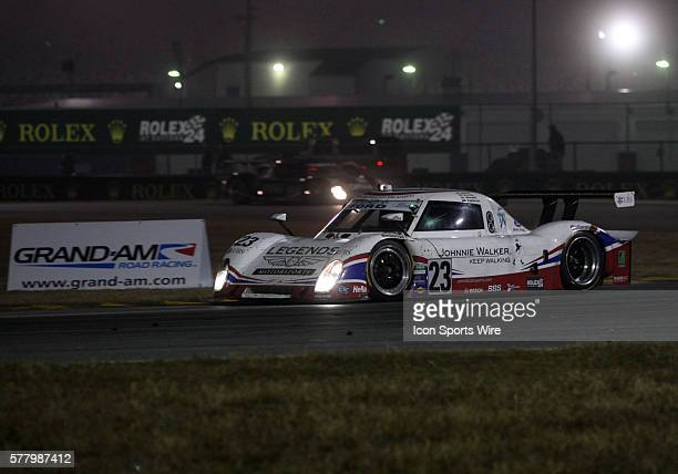 The United Autosports with Michael Shank Racing car driven by Mark BlundellZak Brown Martin Brundle and Mark Patterson enters the horseshoe turn...