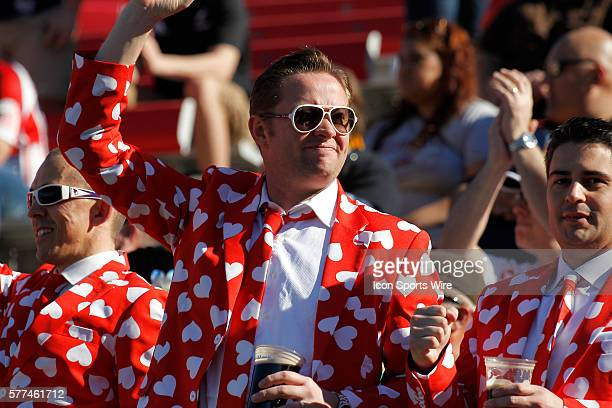 Fans dressed in heart suits cheer during the England versus Uruguay match during day two of round 4 at the HSBC Sevens World Series of Rugby at Sam...