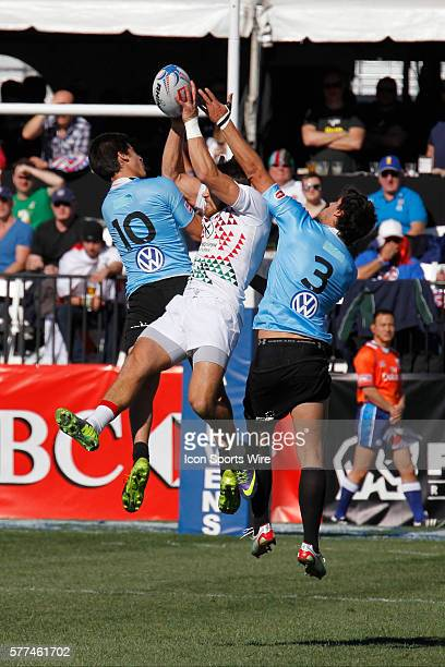 Francisco Lopez and Santiago Martinez of Uruguay defend against England during day two of round 4 at the HSBC Sevens World Series of Rugby at Sam...