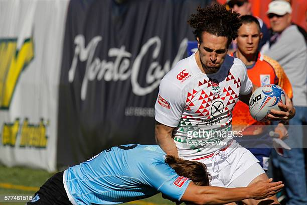 Mike Ellery of England tries to break through a tackle during day two of round 4 at the HSBC Sevens World Series of Rugby at Sam Boyd Stadium in Las...