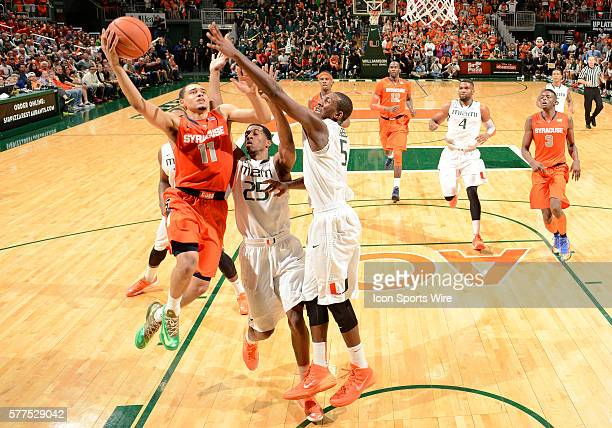 Syracuse University guard Tyler Ennis shoots against University of Miami guard Davon Reed in Syracuse's 6452 victory at BankUnited Center Coral...