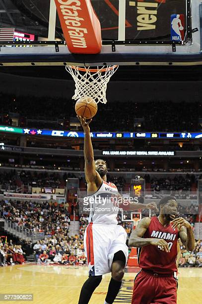 Washington Wizards power forward Nene Hilario in action against Miami Heat power forward Udonis Haslem as the Washington Wizards defeated the Miami...