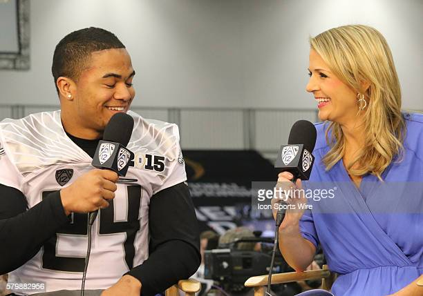 Ashley Adamson of the Pac 10 Network interviews Oregon Ducks running back Thomas Tyner during the media day at the Kay Bailey Hutchinson Convention...