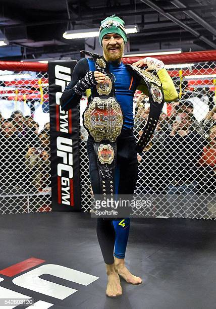 15 January 2015 Conor McGregor holds two UFC title belts during an open workout session ahead of his fight against Dennis Siver in TD Garden Boston...