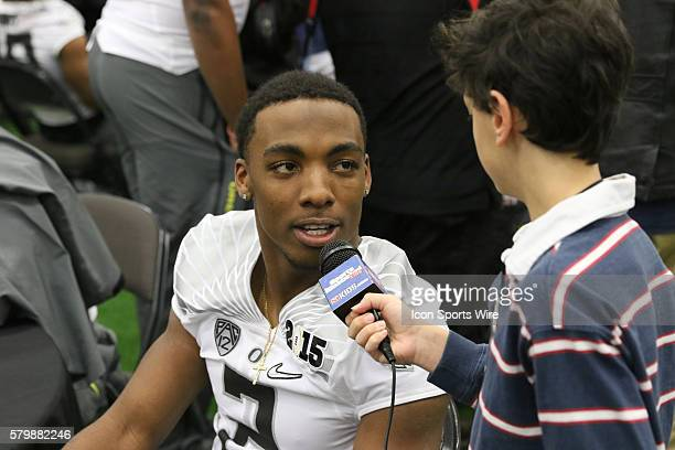 Oregon Ducks safety Tyree Robinson is interviewed by Jake Aron of SI Kids during the College Football Playoff National Championship media day held at...