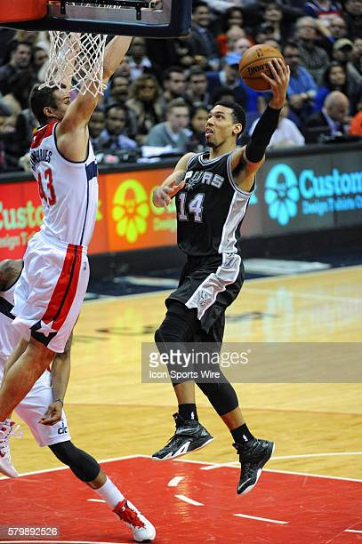 San Antonio Spurs guard Danny Green in action against Washington Wizards forward Kris Humphries at the Verizon Center in Washington DC where the...