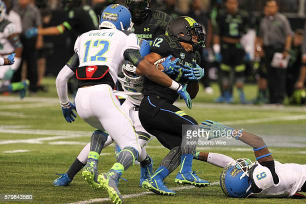 Team Armour wide receiver Christian Kirk is tackled by Derwin James Brian Cole and Jahvoni Simmons of Team Highlight during the 2015 Under Armour...
