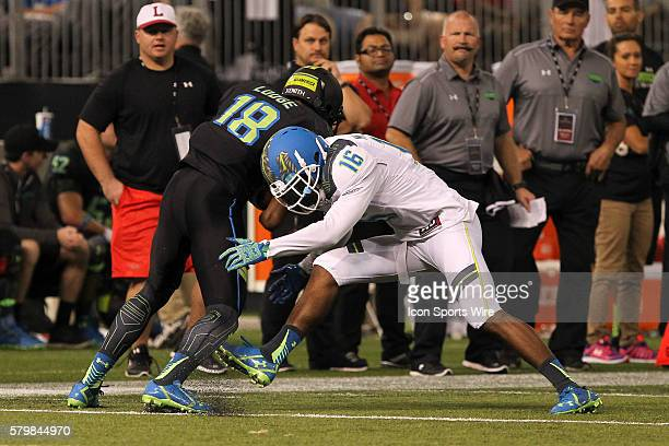 Team Highlight defensive back Marcus Lewis tackles Team Armour wide receiver DaMarkus Lodge during the 2015 Under Armour AllAmerica Game at Tropicana...