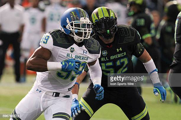 Team Highlight defensive end Byron Cowart and Team Armour offensive lineman Ryan Bates in action during the 2015 Under Armour AllAmerica Game at...