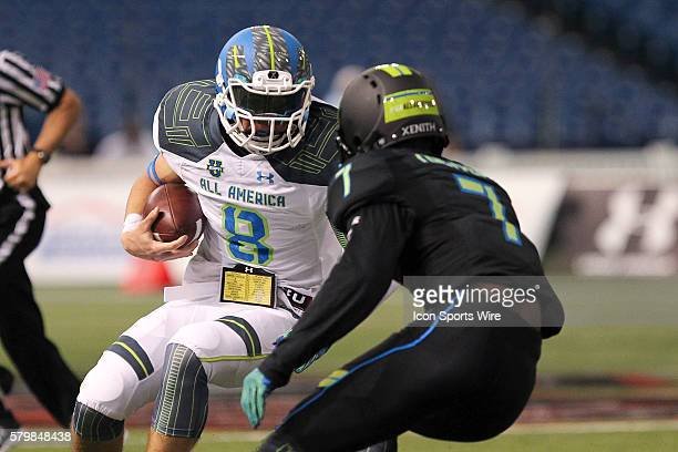Team Highlight quarterback Blake Barnett tries to avoid Team Armour defensive back Kevin Toliver II during the 2015 Under Armour AllAmerica Game at...