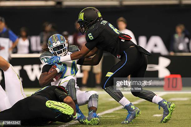 Team Highlight running back Ronald Jones II is tackled by Team Armour linebacker Adonis Thomas during the 2015 Under Armour AllAmerica Game at...