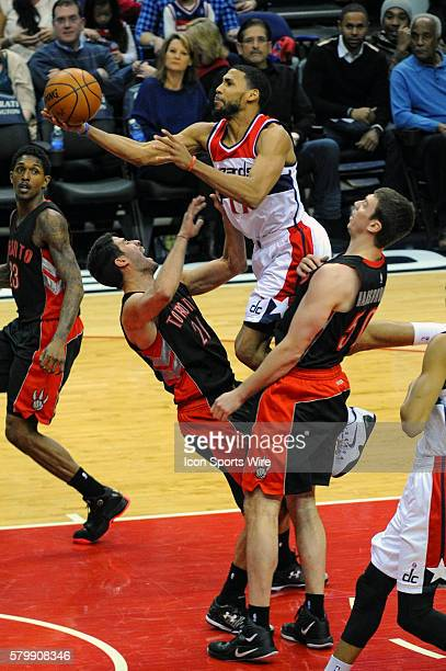 Washington Wizards guard Garrett Temple is called for an offensive foul against Toronto Raptors guard Greivis Vasquez at the Verizon Center in...