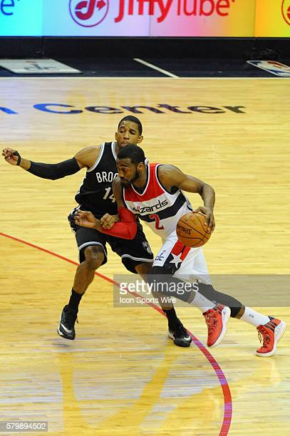 Washington Wizards guard John Wall drives to the basket against Brooklyn Nets guard Darius Morris at the Verizon Center in Washington DC where the...