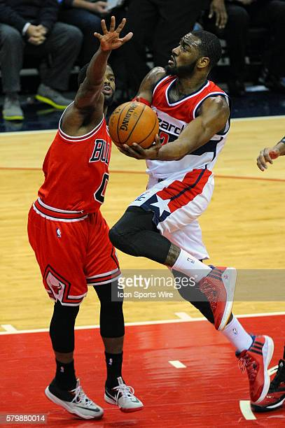 Washington Wizards guard John Wall scores on a fast break and is fouled by Chicago Bulls guard Aaron Brooks at the Verizon Center in Washington DC...