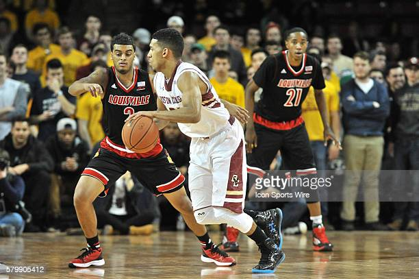 Boston College Eagles guard Olivier Hanlan drives across the court in front of Louisville Cardinals guard Quentin Snider during the Boston College...