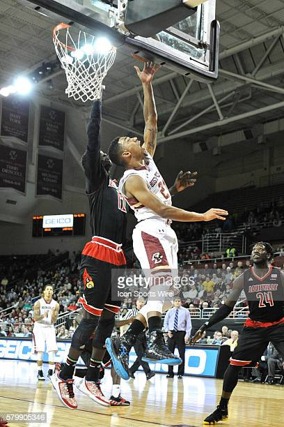 Boston College Eagles guard Olivier Hanlan throws up a reverse shot on the basket during the Boston College Eagles game against the Louisville...