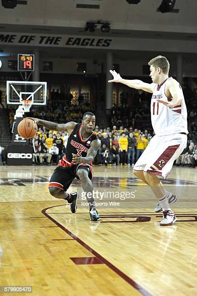 Louisville Cardinals guard Chris Jones gets ready to drive to the basket during the Louisville Cardinals game against the Boston College Eagles at...