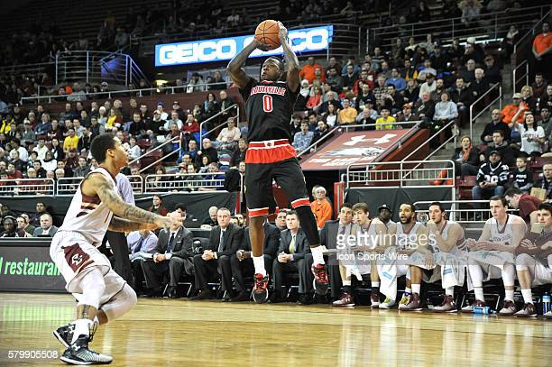 Louisville Cardinals guard Terry Rozier goes up for a short jump shot putting up 23 points on the night during the Louisville Cardinals game against...