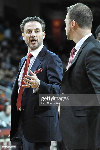Louisville Cardinals head coach Rick Pitino talks to his assitant during the Louisville Cardinals game against the Boston College Eagles at Conte...