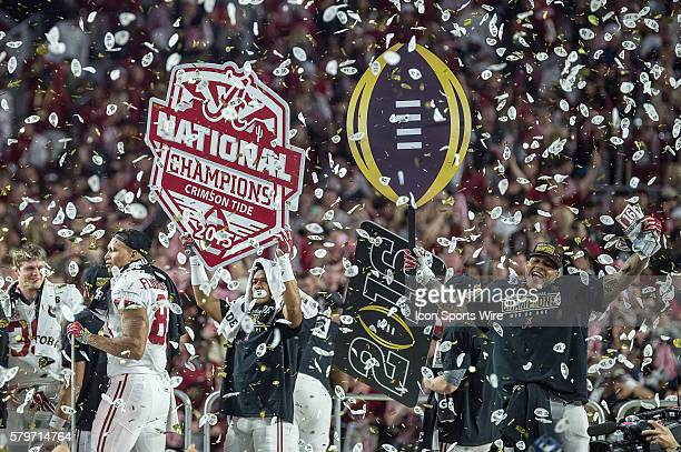 Alabama Crimson Tide players celebrate after winning the 2016 CFP National Championship trophy in action during a game between the Alabama Crimson...