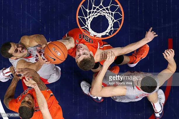 Arizona Wildcats forward Ryan Anderson and center Dusan Ristic fight for a rebound with Oregon State Beavers forward Tres Tinkle during the first...