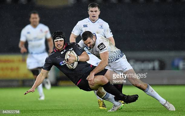 January 2016; Dan Evans, Ospreys, is tackled by Rob Kearney, Leinster. Guinness PRO12, Round 12, Ospreys v Leinster. Liberty Stadium, Swansea, Wales....
