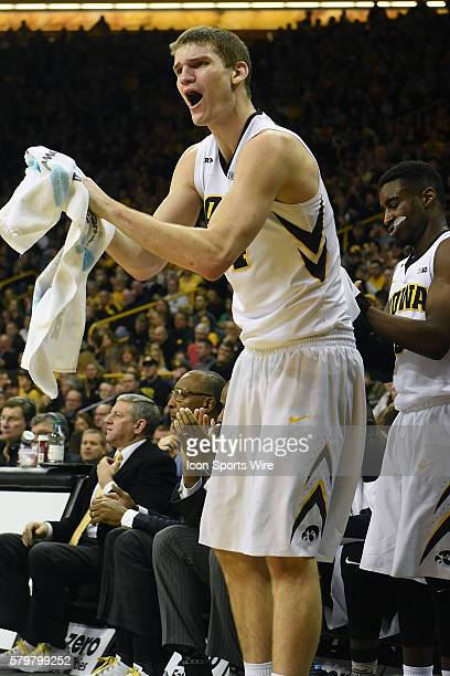 Iowa Hawkeyes center Adam Woodbury cheers on his teammates from the bench in the first half during a Big Ten Conference mens basketball game between...