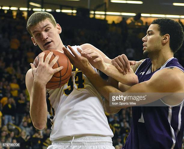 Iowa Hawkeyes center Adam Woodbury hangs on to a rebound during a Big Ten Conference mens basketball game between the Northwestern Wildcats and the...