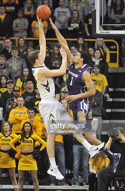Iowa Hawkeyes center Adam Woodbury puts up a shot over Northwestern center Joey van Zegeren during a Big Ten Conference mens basketball game between...
