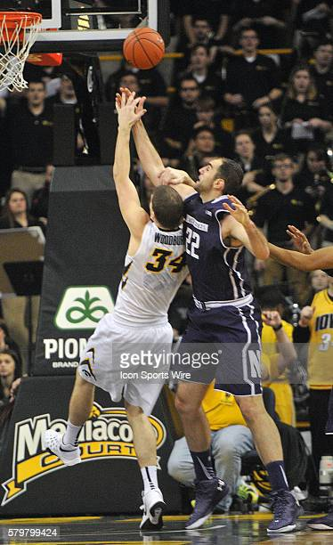 Iowa Hawkeyes center Adam Woodbury shoots over Northwestern center Alex Olah in the second half during a Big Ten Conference mens basketball game...