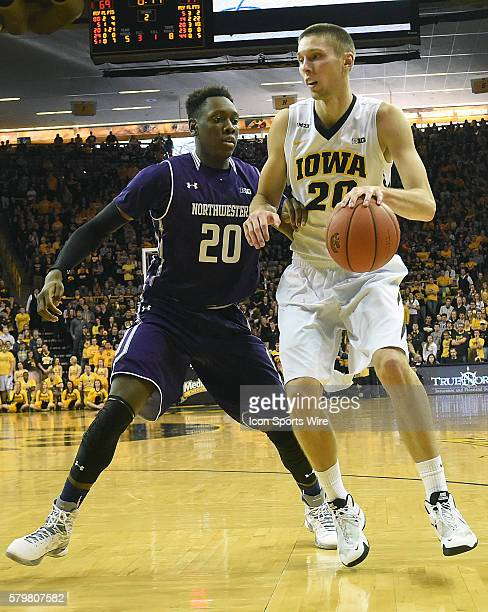 Iowa Hawkeyes forward Jarrod Uthoff tries to go around Northwestern guard Scottie Lindsey during a Big Ten Conference mens basketball game between...