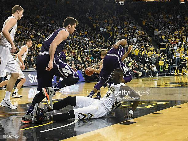 Iowa Hawkeyes guard Peter Jok falls down on the court during a Big Ten Conference mens basketball game between the Northwestern Wildcats and the Iowa...