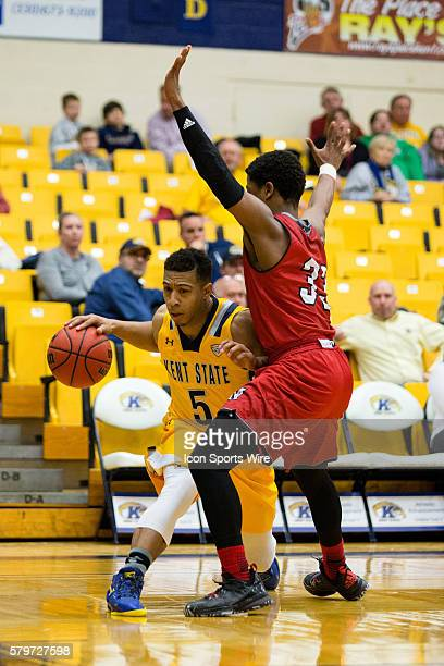 Kent State Golden Flashes G Kellon Thomas is defended by Miami Redhawks G Eric Washington during the second half of the NCAA Men's Basketball game...